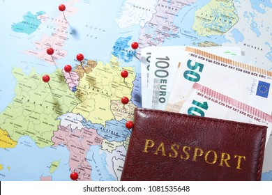 European road trip with euro bank notes, passport and markers on map
