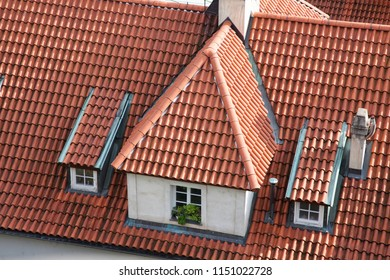 European roof closeup with attic and windows