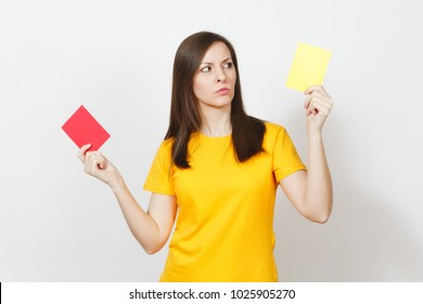 European serious severe young woman, football referee hold choose yellow and red soccer cards, propose player retire from field isolated on white background. Sport, play, healthy lifestyle concept