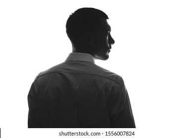 European silhouette of man in profile from behind in business shirt looking to side isolate on white - Shutterstock ID 1556007824