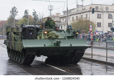 European street, Prague-October 28, 2018: Soldiers of Czech Army are riding armoured recovery vehicle VT-72M4 CZ on military parade on October 28, 2018 in Prague, Czech Republic