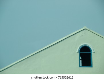 european style mood of minimalism house facade with small window crop closeup isolated on natural bright blue sky outdoor on a sunny day for backdrop or background use