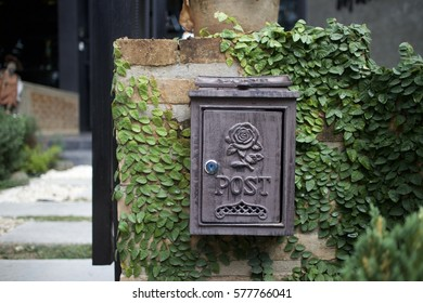 European style vintage mail box on brick wall.