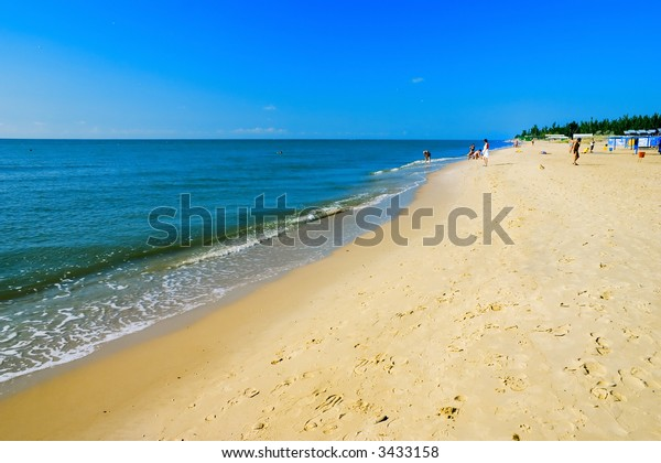 The European summer beach scene. Blue Sky