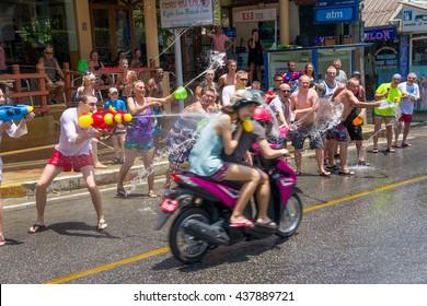 European tourists celebrate the traditional Thai New Year, poured water. Songkran Festival. April 13, 2016, Kata, Phuket, Thailand.