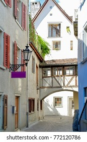 European town alley with single pigeon on cobblestone street