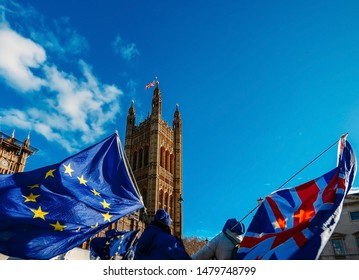 European Union and British Union Jack flag flying in front of Houses of Parliament at Westminster Palace, London - Brexit EU referendum theme