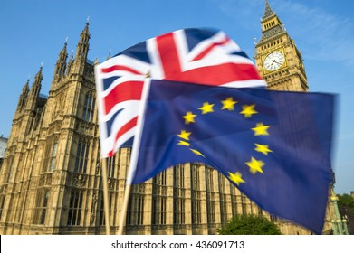 European Union and British Union Jack flag flying in motion blur in front of Big Ben and the Houses of Parliament at Westminster Palace, London, in preparation for the Brexit EU referendum