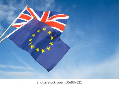 European Union and British Union Jack flag flying in front of bright blue sky in a statement of the Brexit EU referendum