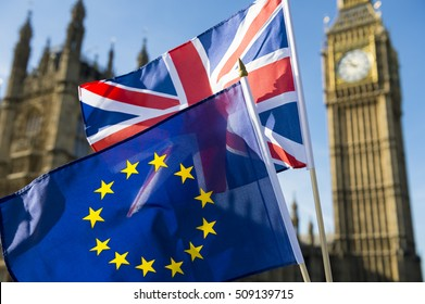 European Union and British Union Jack flag flying in front of Big Ben and the Houses of Parliament at Westminster Palace, London, in symbol of the Brexit EU referendum. Selective focus.