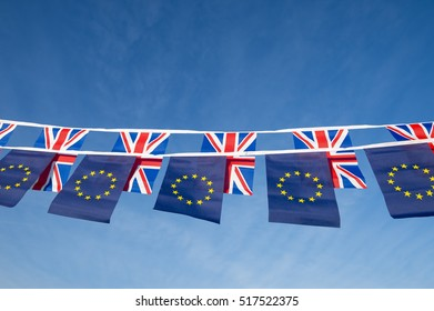 European Union and British Union Jack flag bunting flying in bright blue sky in a statement of the Brexit EU referendum