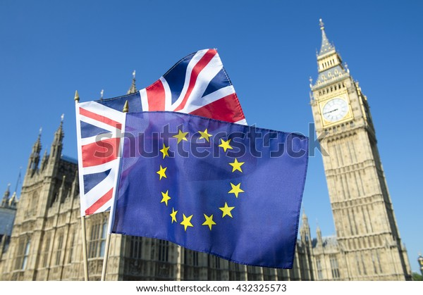 European Union and British Union Jack flag flying in front of Big Ben and the Houses of Parliament at Westminster Palace, London, in preparation for the Brexit EU referendum