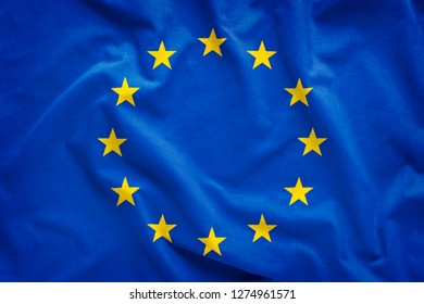 European Union EU flag blowing in the wind in full frame background concept