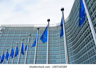 European Union (EU) flags in front of the Berlaymont building of the European Commission in Brussels