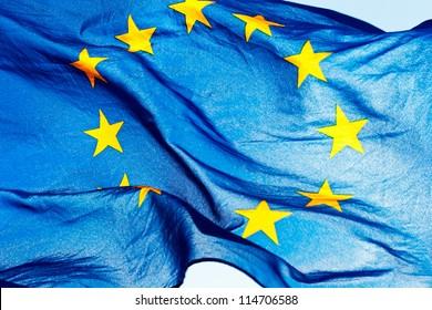 European union flag against the sky and sunlight