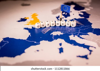 European union flag and graphene word over a map of europe, suitable as transparent flexible future graphene use or Graphene Flagship, Europe's biggest ever research initiative