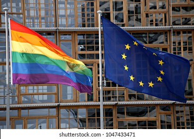 European union flag and LGBT pride flag wave  in Brussels, Belgium on May 17, 2017.