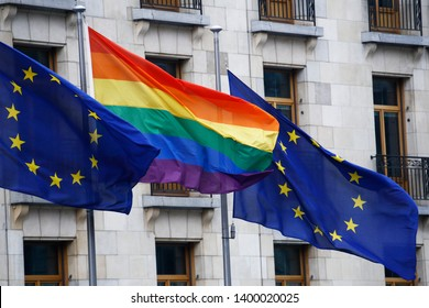European union flag and LGBT pride flag wave outside of European Council building  in Brussels, Belgium on May 17, 2019.