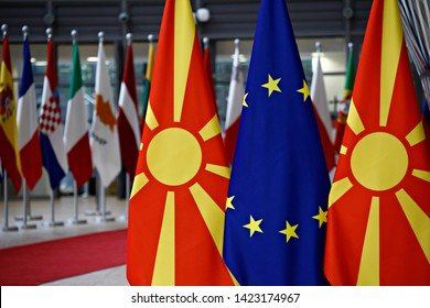 European union flag and flag of Macedonia in the EU council building Brussels, Belgium on June 12, 2019