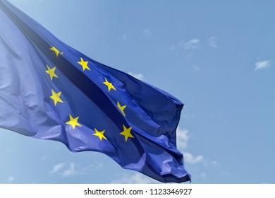 European union flag on the blue sky background.