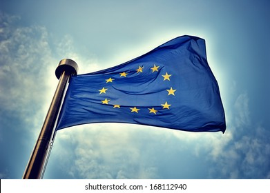European Union flag on blue sky background
