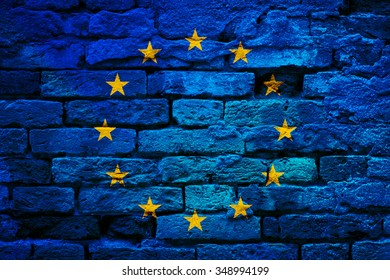 European union flag painted on old aged brick wall texture background.