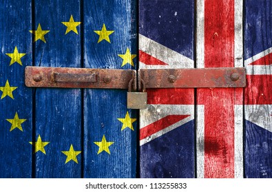 European Union flag with the UK flag on the background of old locked doors