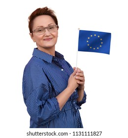 European Union flag. Woman holding flag of the EU. Nice portrait of middle aged lady 40 50 years old with the European Union flag isolated on white background