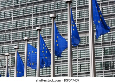 European Union flags against the European Parliament building