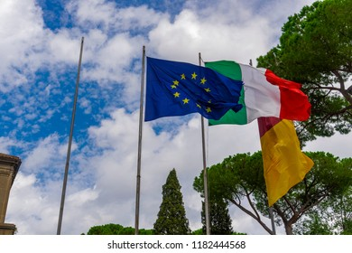 European Union, Italian and Rome flags waving. Flags flying on a mast at Capitoline Hill Rome, Italy.