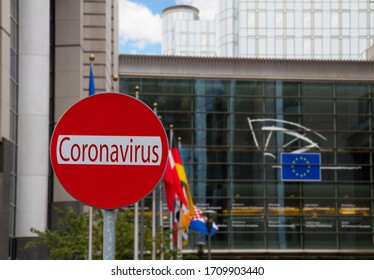 European Union parlament with flagpoles and Covid sign, coronavirus lockdown concept