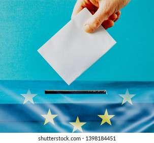 european Union parliament election concept - hand putting ballot in blue election box - EU flag