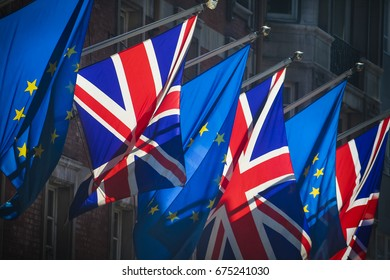 European Union and United Kingdom flags together on sunny day