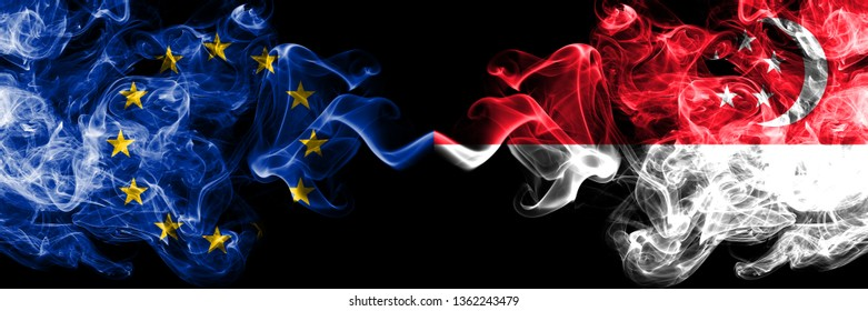 European Union vs Singapore, Singaporean smoke flags placed side by side. Thick colored silky smoke flags of EU and Singapore, Singaporean