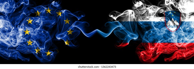 European Union vs Slovenia, Slovenian smoke flags placed side by side. Thick colored silky smoke flags of EU and Slovenia, Slovenian