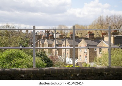 European urban city view behind the fence in West London, United Kingdom