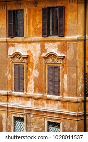 European windows with wooden shutters. Old house exterior.