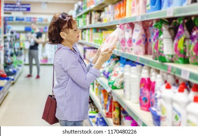 European woman customer buying detergents for laundry home appliances cosmetics in shopping mall