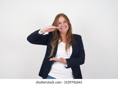 European woman over isolated background gesturing with hands showing big and large size sign, measure symbol. Smiling looking at the camera. Measuring concept.