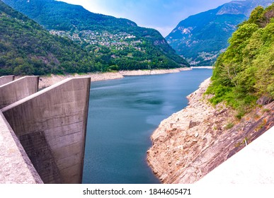 Europe.Switzerland.Dam on the Verzasca River.Valley of Verzasca surrounded by the Alps.Crystal clear water.