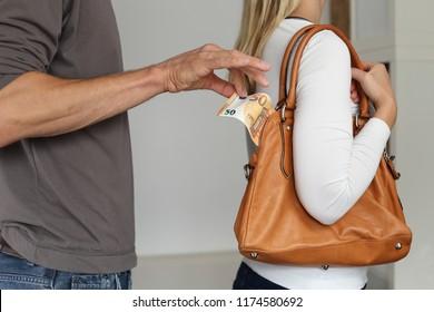 Euros Cas Pickpocketing out of a womens handbag