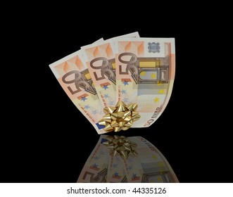 Euros with a gold bow on a black background