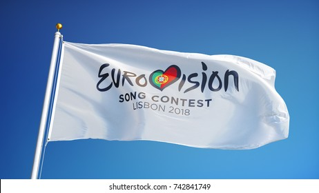 Eurovision Song Contest 2018 in Lisbon flag waving against blue sky, editorial image, close up, isolated on clear blue background.