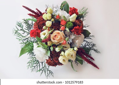 Eustoma, a wedding bouquet, flowers in hands, a bouquet on a white background, a diverse design bouquet, a decorative composition of flowers and coniferous branches