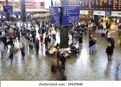 Euston station in the rush hour, London UK. All faces blurred beyond recognition and trademarks/logos removed.