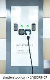 EV Car Charger. Electric car. Charging Station with the power cable. Technology car.  Future transport. Recharging. High technology . Transportation EV. Transport EV car. Innovation future.