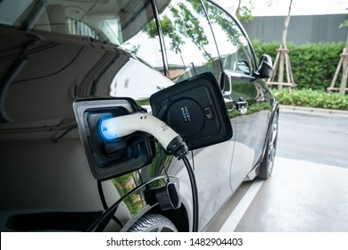 EV Car. Electric car. Charging Station with the power cable plugged in.Technology car. A Future transport. Recharging. High technology . Transportation EV. Transport EV car. Innovation future.