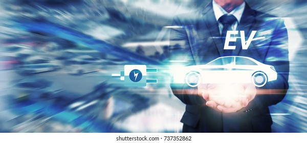 EV car, electric car in hand for green energy Business man hold EV car icon for energy save and future technology in car park background