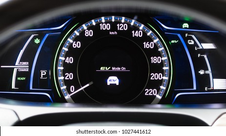 EV- Electrical vehicle mode turned on on hybrid car screen in front of steering wheel for green power fuel transportation technology, environmental eco- friendly, and  saving energy concept
