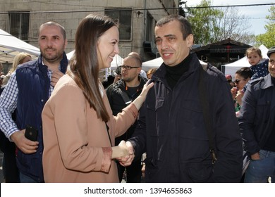 Eva Maydell, member European Parliament from Bulgaria's GERB Party and Todor Chobanov on a farmers market in Sofia, Bulgaria - 04/21/2019. She has been serving on the Committee on the Internal Market